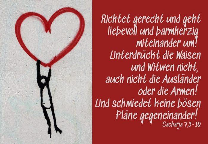 Wandbild Männchen hängt an rotem Herz